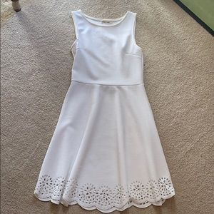 White dress with flower pattern on bottom